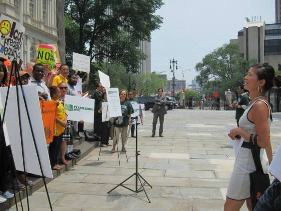 Cathy Dang of CAAAV: Organizing Asian Communities leads chants at the June 11 press event