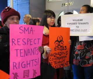Tenants express concern in English and Chinese about lead levels in their homes.