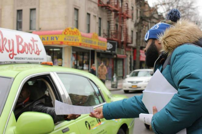 UHAB members distribute tenants' rights information to neighbors.