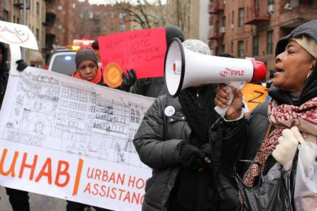 UHAB tenant leaders lead other tenants through a march.